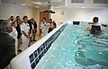 US Navy 110907-N-AW702-078 Capt. Lynn Welling, commanding officer of Naval Hospital Jacksonville, gives a tour of the new aquatic treadmill.jpg