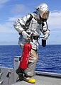 US Navy 110927-N-WJ771-100 Aviation Support Equipment Technician 2nd Class Joshua B. Cary carries a CO2 fire extinguisher onto the flight deck of U.jpg