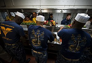 US Navy 111225-N-DR144-178 Chief petty officers serve Christmas dinner on the mess decks aboard the Nimitz-class aircraft carrier USS Carl Vinson (.jpg