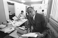 Vernon E. Jordan working on a voter education project.jpg
