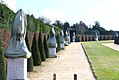 Versailles garden at winter - statues protected to not felling the cold... (9129890551).jpg
