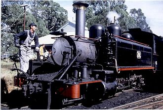 Puffing Billy Railway - V.R. NA Class 7A at Menzies Creek on 12 April 1971 with fireman clearing ash from the smokebox