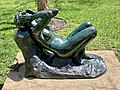 Water dragon hiding in a shade of a sculpture at Queensland Art Gallery, Brisbane 01.jpg