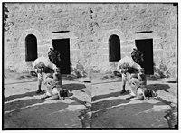 Weli of Budrieh at Sherafat and the preparing of a sacrifice. Preparing to skin the sheep. LOC matpc.01419.jpg