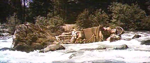 The settlers' raft is caught in rapids.