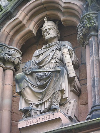 Statue of William the Conqueror, holding Domesday Book on the West Front of Lichfield Cathedral. William I, Lichfield Cathedral.jpg