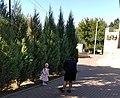 Woman makes photo of a girl near Slava monument in Chaltyr.jpg