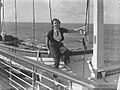 "Woman posing on the lifeboat of the ""Mariposa"" (AM 79746-1).jpg"