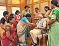 Women from various segments of society tying 'Rakhi' on the Prime Minister, Shri Narendra Modi's wrist, on the occasion of 'Raksha Bandhan', in New Delhi on August 29, 2015 (1).jpg