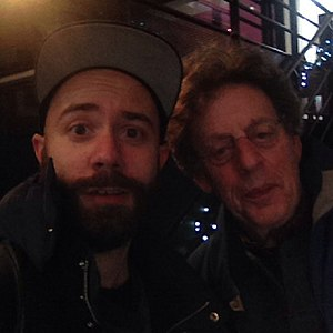 Yoann Lemoine - Woodkid and Philip Glass after their conference about New York Minimalism at the Opera de Saint Etienne in 2014