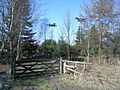 Woodland, gates and mobile mast - geograph.org.uk - 741173.jpg