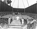 Workmen lay the keel plate of USS United States (CVA-58) on 18th April 1948.jpg
