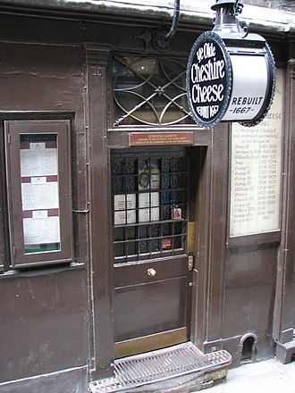 Ye Olde Cheshire Cheese - All the monarchs who have reigned in England during the pub's time are written to the right of the door