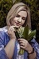 День Вишиванки. Молода україночка у вишитій синій сукні серед квітів 24.jpg