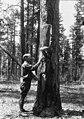 1932. Walter J. Buckhorn examines field cage on ponderosa pine Dendroctonus brevicomis Lec. brood trees. Prineville, Oregon. (33983082945).jpg