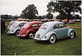 1957 VW Beetle - Kafer 1200 with younger siblings (15931805943).jpg