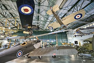 Royal Air Force Museum London - Hangar 2, Grahame-White Factory interior, Royal Aircraft Factory SE.5a in the foreground, FE.2b, Sopwith Camel and Fokker D.VII suspended from the ceiling