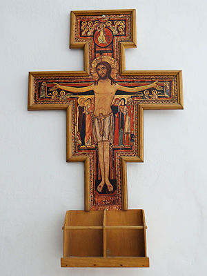 Lamb of God - San Damiano Cross depicts the sacrificial Christ as Agnus Dei