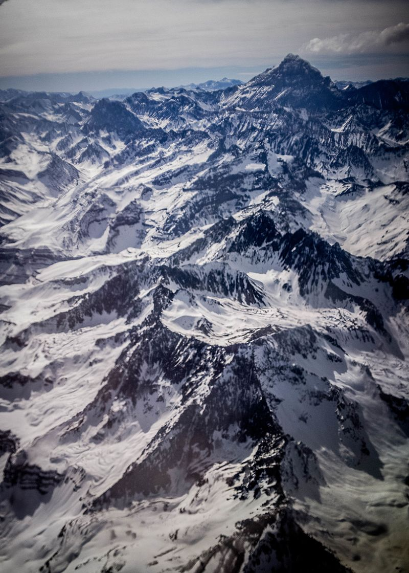 Mountain tops, with clouds shown.