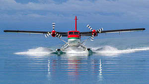 Water landing - A Twin Otter float plane completing a water landing