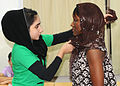 A Bahraini student shows U.S. Navy Quartermaster 1st Class Angela Everett how to wrap her hair in the local custom.jpg