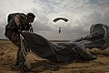 A U.S. Air Force pararescueman with the 82nd Expeditionary Rescue Squadron gathers his parachute during training near Camp Lemmonier, Djibouti, March 14, 2014 140314-F-YM869-278.jpg