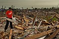 A U.S. Airman based at Sheppard Air Force Base, Texas, cleans up debris June 8, 2013, in Moore, Okla 130608-F-ZB240-095.jpg