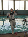 A U.S. Army officer candidate from Bravo Company, 3rd Battailon, 11th Infantry Regiment enters a swimming pool during the combat water survival portion of Officer Candidate School March 14, 2008, at Fort 080314-A-XR214-066.jpg