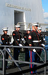 A U.S. Marine rifle honor guard from 3rd Marine Regiment salutes as the family of Pfc. Frank Cabiness carry his urn aboard the USS Arizona Memorial, Dec. 23, 2011 111223-M-AC000-853.jpg