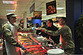 A U.S. Service member, left, works with other coalition forces senior leaders to help serve Thanksgiving dinner to service members and contractors at the dining facility at the International Security Assistance 131128-A-UO630-002.jpg