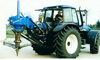 Stump grinder - Image: A big rotor stump grinder with new holland tractor