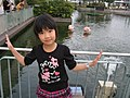 A girl next to flamingo pond, Sea Paradise, Yokohama, Japan; May 2011.jpg