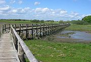 Aberlady Bay footbridge as it looks towards a nature reserve