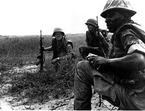 United States Air Force Security Forces - USAF Security Police from Tan Son Nhut Air Base watch for Viet Cong infiltration attempts along the base perimeter during the Vietnam war.