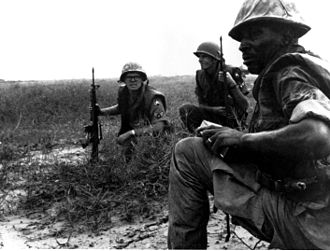 USAF Security Police from Tan Son Nhut Air Base watch for Viet Cong infiltration attempts along the base perimeter during the Vietnam war AirForceSecurityPoliceTanSoNnhut.jpg