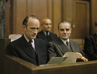 Alfried Krupp von Bohlen und Halbach - Alfried Krupp von Bohlen und Halbach reading a document, seated in the dock, as a defendant at the Krupp Trial