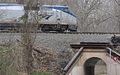 Amtrak train at Colchester Overpass aka Bunnyman Bridge.jpg