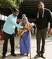 An old woman being carried at a polling booth to cast her vote, during the 2nd phase of Gujarat Assembly Election, in Gandhinagar, Gujarat on December 14, 2017.jpg