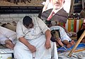 Anti-coup protesters resting outside Rabaa al-Adawiya mosque Cairo 11-July-2013.jpg