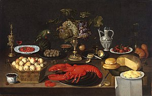 Artus Claessens - Image: Artus Claessens Still Life of Fruit, a Lobster, Cheeses and Drinking Vessels with a Parrot and a Squirrel on a Table
