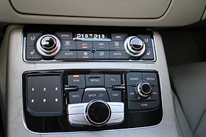 Multi Media Interface - A left-hand drive 2014 Audi A8 (D4), showing the MMI controls