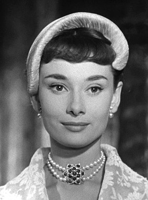 Half hat - Audrey Hepburn wore a half-hat with a halo-effect brim in the 1953 film Roman Holiday
