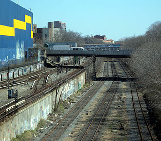 Bay Ridge Branch - Triple track, sharing an open cut with BMT Sea Beach Line (left)