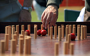 Bagatelle - A game of bagatelle in progress.