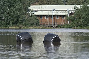 English: Bales in flood The River Dove near Ro...