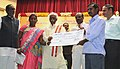 Bandaru Dattatreya distributing the financial assistance to the beneficiaries, at the Vishwakarma Day -National Labour Day celebrations, organised by the Ministry of Labour & Employment, in Hyderabad (1).jpg