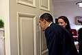 Barack Obama looking through the Oval Office door peephole.jpg