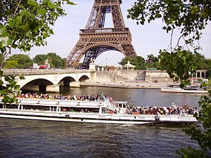 Bateau Mouche on river Seine near the Pont d'Iéna and Eiffel Tower in Paris, France.jpg