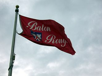 Flag of Baton Rouge, Louisiana - The flag of Baton Rouge flying on a cloudy day.