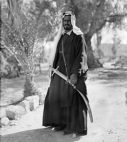 Bedouin sheikh with a sword